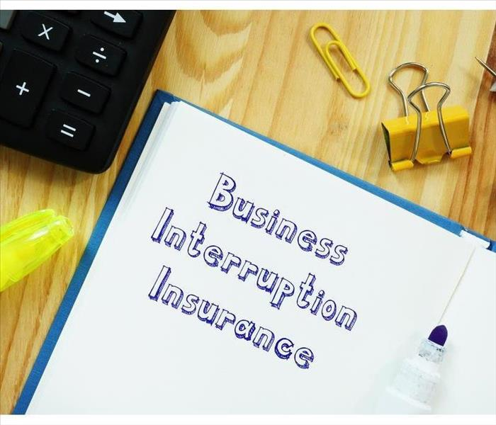 Financial concept meaning Business Interruption Insurance with sign on the piece of paper.